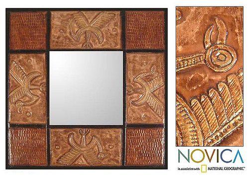 Oglinda cu rama de piele sculptata